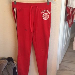Red justice track pants